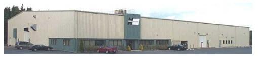 Un bâtiment avec un toit beige, long et plat en métal avec une porte d'entrée au centre. Ce bâtiment   à un étage abrite actuellement Hawboldt Industries. Il se trouve sur la Route 14 à la sortie du village de Chester.
