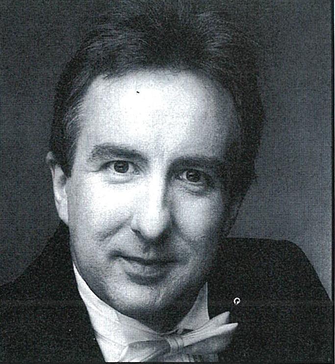 Une photographie du visage de Michael Reason