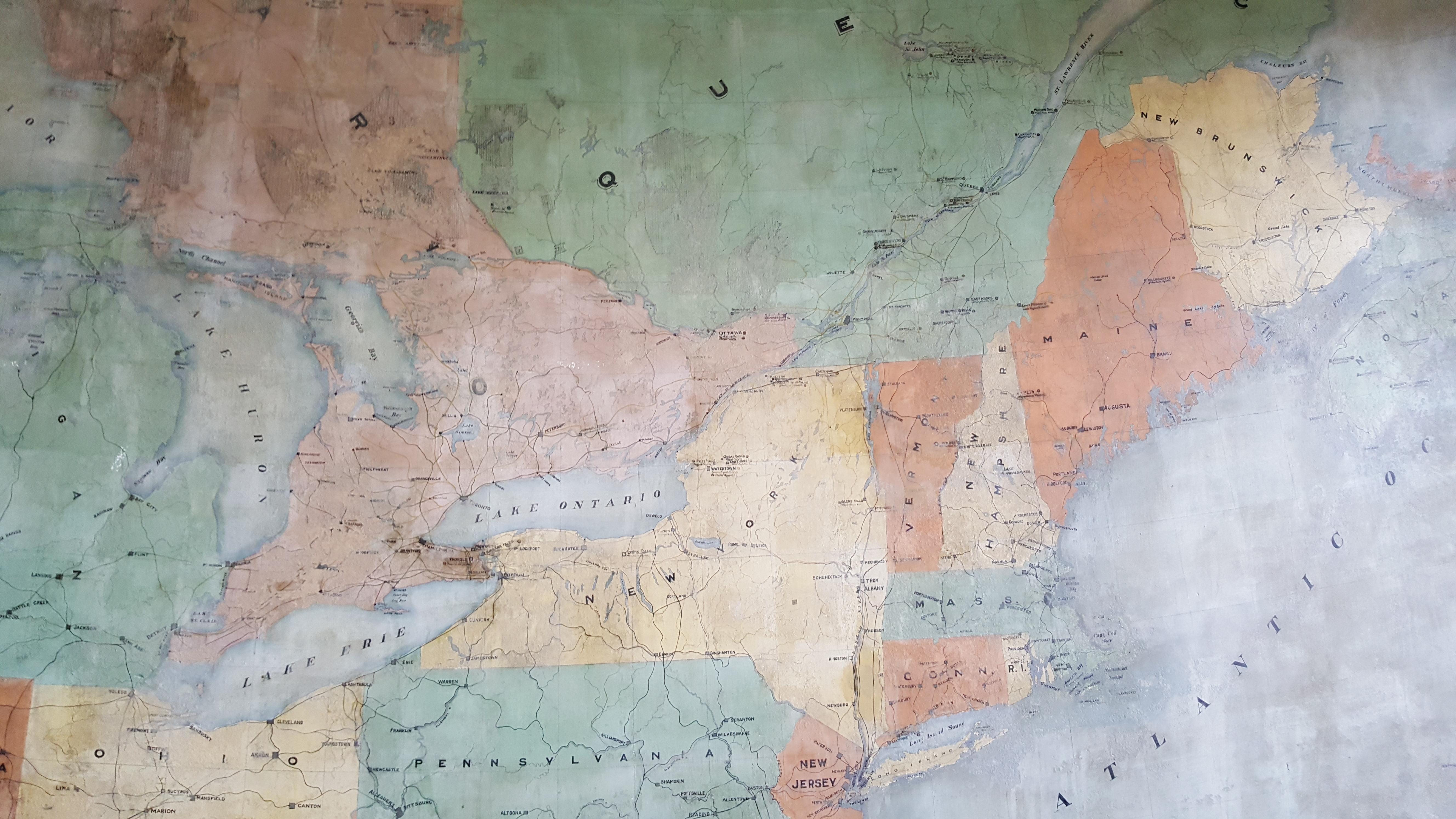 Carte géographique peinte en 1901 illustrant les Grands Lacs, l'Ontario, le Québec, l'océan Atlantique et le Nord-Est américain.